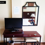 TV, desk, and mirror at Subic Park Hotel