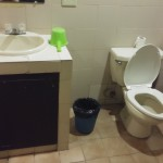 toilet (they have SOME soap and shampoo (they have toothbrush and tiny tubes of toothpaste (Rockpoint Hotspring Resort Hotel review)